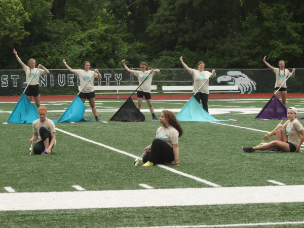 A row of color guard members at practice.